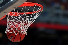 a basketball going through a net